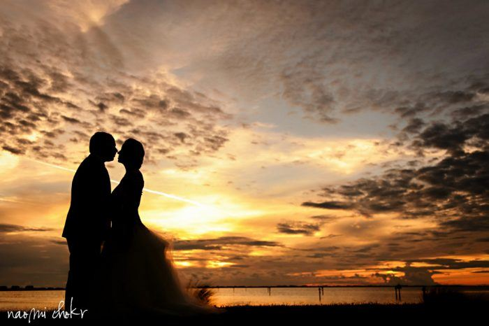 Newlyweds silhouette at sunset